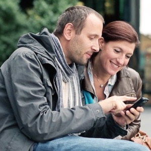 Couple demonstrating business phone app