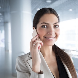 Accountant taking business call on her cellphone